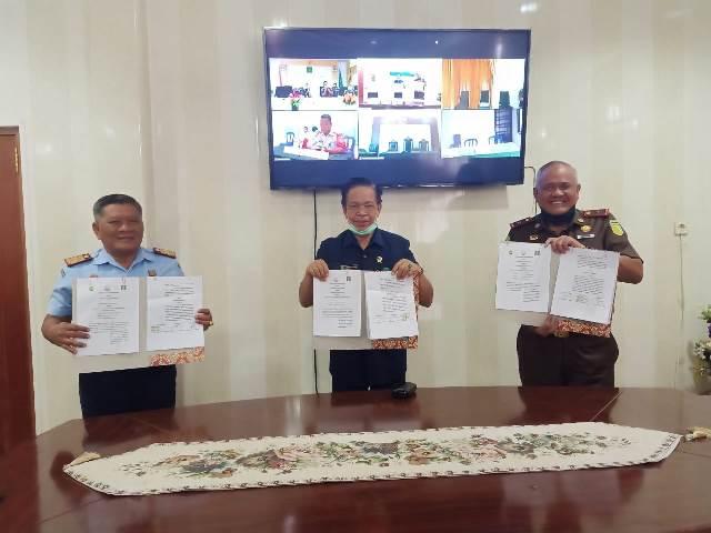 Kejati – PT & Kanwil Kemenkumham Maluku Teken Kesepakatan Sidang 'Online'