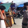 Brimob Maluku Bagikan Masker Kepada Warga Ambon