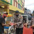 Gegana Polda Maluku Bagikan 100 Paket Makanan Gratis