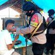 Brimob Maluku Bagikan Masker Di Bula