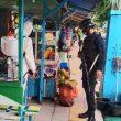 Sambangi Kawasan Wisata Pantai Natsepa, Brimob Semprot Disinfektan