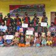 Sambangi Suku Mausu Ane, Satgas Yonif 734/SNS Gelar Bhakti Sosial