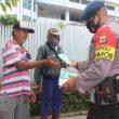 Brimob Maluku Edukasi Protokol Kesehatan & Bagi Masker
